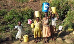 The Water Project:  Girls Fetch Water From Manga Spring