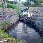 The Water Project: Mwiyala Community, Benard Spring -  Fetching Water
