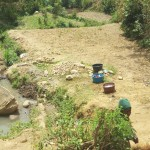 The Water Project: Shikoti Community B -  Woman Washes Clothes At The Spring