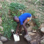 The Water Project: Mumuli Community A -  Fetching Water