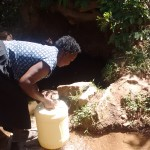 The Water Project: Irenji Community -  Fetching Water