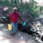 The Water Project: Elunyu Community -  Carrying Water