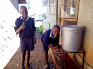 The Water Project : 5-kenya4597-preston-and-billy-use-their-hand-washing-station-installed-last-year