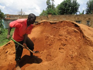 The Water Project:  Mr Ondiek Works To Load Construction Materials Into Trucks