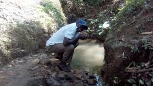 The Water Project:  Mr Erastus Chimwadi Drinking Water From The Spring