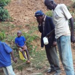 The Water Project: Mumuli Community A -  Man Quenching His Thirst At Spring
