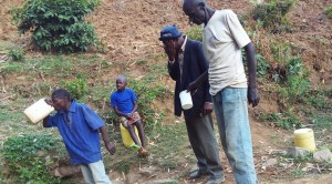 The Water Project : 7-kenya4737-man-quenching-his-thirst-at-spring