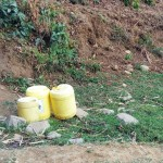 The Water Project: Mumuli Community, Shalolwa Spring -  Water Containers