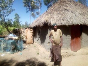 The Water Project : 8-kenya4738-mrs-omosh-outside-her-grass-thatched-house
