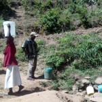 The Water Project: Handidi Community, Matunda Spring -  Carrying Water