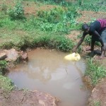 The Water Project: Simuli Community, Lihala Sifoto Spring -  Fetching Water