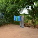 The Water Project: Kivani Community -  Pius Household Clothesline