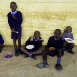 The Water Project: Mumias Central Primary School -  Students Eating During Break