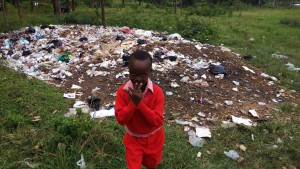 The Water Project:  Student Posing In Front Of Trash