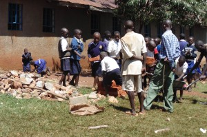 The Water Project:  Students Shuttling Bricks To The Artisans