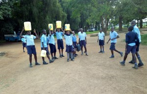 The Water Project:  Students Returning With Fetched Water