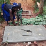 The Water Project: Visiru Community, Kitinga Spring -  Mrs Mwinamo At Her Newly Casted Platform