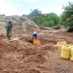 The Water Project: Ikulya Community -  Fetching Water