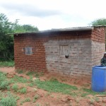 The Water Project: Ikulya Community A -  Household Water Storage