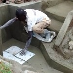 The Water Project: Mahanga Community -  Artisan Places Tiles At The Spring
