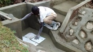 The Water Project : 34-kenya4720-artisan-places-tiles-at-the-spring