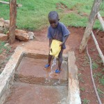 The Water Project : 36-kenya4720-children-cleaning-the-spring-area