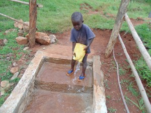 The Water Project:  Children Cleaning The Spring Area