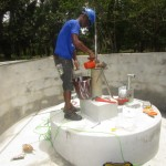 The Water Project: Ponka Village -  Installing Pump