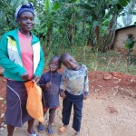The Water Project: Mahanga Community -  Mercy Angeyo With Her Children At The Casted Sanitation Platform