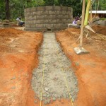 The Water Project : 54-sierraleone5105-building-the-new-well-pad