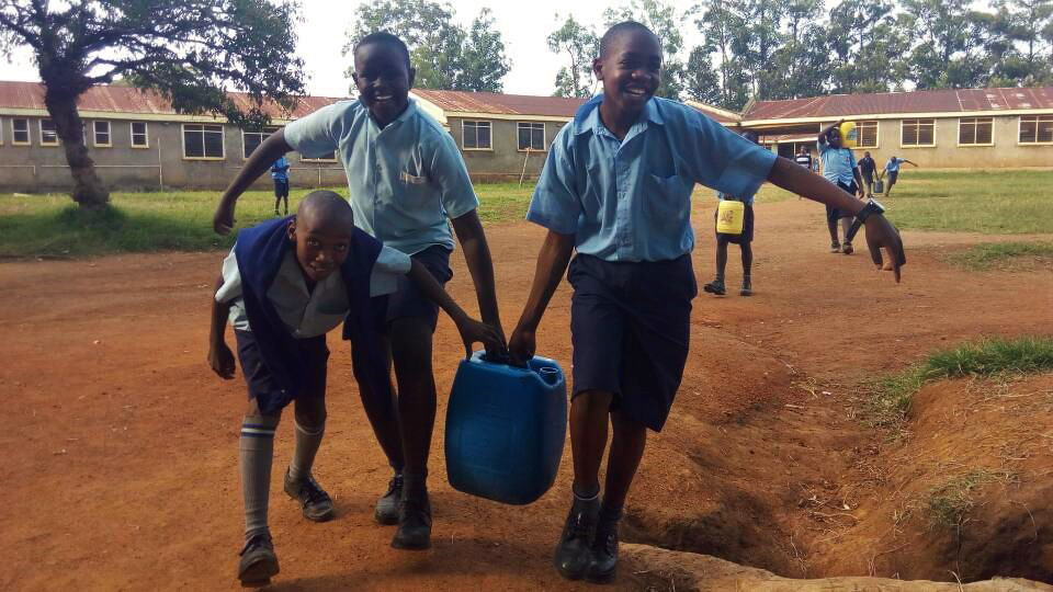 The Water Project : 7-kenya4841-students-arriving-with-water