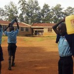 The Water Project: Mumias Central Primary School -  Students Arriving With Water