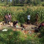 The Water Project: Handidi Community -  Locals Inspect Progress On Their Spring