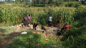 The Water Project : 1-kenya4725-locals-inspect-progress-on-their-spring