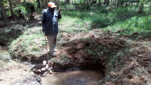 The Water Project:  Mr Shadrack Muuchi Showing Us The Spring