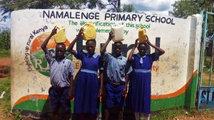 The Water Project:  Students Posing With Water Containers At School Entrance