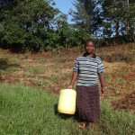 The Water Project: Shitungu Community C -  Mrs Makale Heading To The Spring