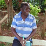 The Water Project: Nyira Community, Ondiek Spring -  Harrison Kamadi Listening During The Training Sessions