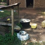 The Water Project: Namalenge Primary School -  Dish Rack And Drinking Cups On Ground