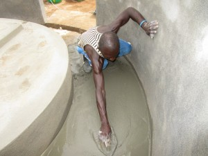The Water Project : 10-sierraleone5121-building-the-well-pad