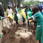 The Water Project: Ebukanga Primary School -  Mixing Cement Together