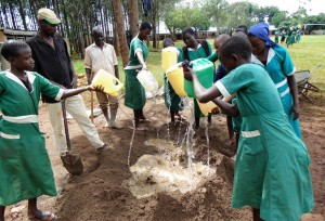 The Water Project:  Mixing Cement Together