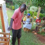 The Water Project : 11-kenya4719-ondiek-oliver-explaining-the-role-of-the-community-in-the-project