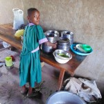The Water Project: Chandolo Primary School -  Student Helping In The Kitchen