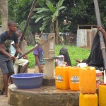 The Water Project: Benke Community, Brima Lane -  People Still Using The Well During Construction