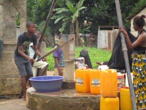 The Water Project:  People Still Using The Well During Construction