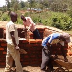 The Water Project: Eshisuru Primary School -  Artisans And Locals Working On Latrines