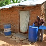 The Water Project: Ngaa Community -  Household Water Containers
