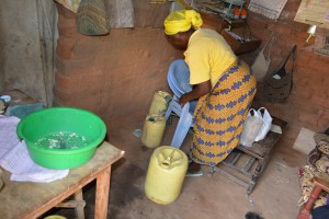 The Water Project:  Justina Pius Gathering Her Water Containers