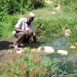 The Water Project: Chegulo Community, Shakava Spring -  Mr Shakava Removing Contaminants